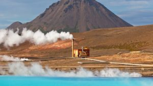 Geothermal Power Station and Bright Turquoise Lake in Iceland at Summer Sunny Day